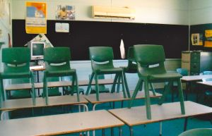my classroom with desks and chairs