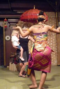 Finding my moment when a Legong dancer in Bali invites my daughter Kasey and me to join her on stage.  I definitely couldn't match the grace, but I tried!
