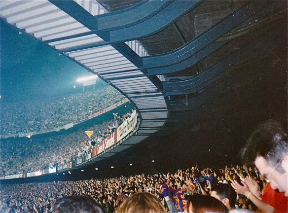 "Finding my moment at Camp Nou in Barcelona, Spain (1995). Chanting ""Barca!"" with about 95,000 spectators this was probably the biggest cultural moment I've experienced. I also spoke in caveman Spanish to the man sitting next to me. I told him how excited I was to be at the game. ""Me gusta fútbol de España mucho!""  Soon he shared his sunflower seeds with me."