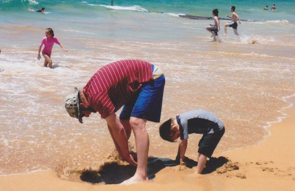 Kurt and Eddie digging a hole at Manly Beach, Australia