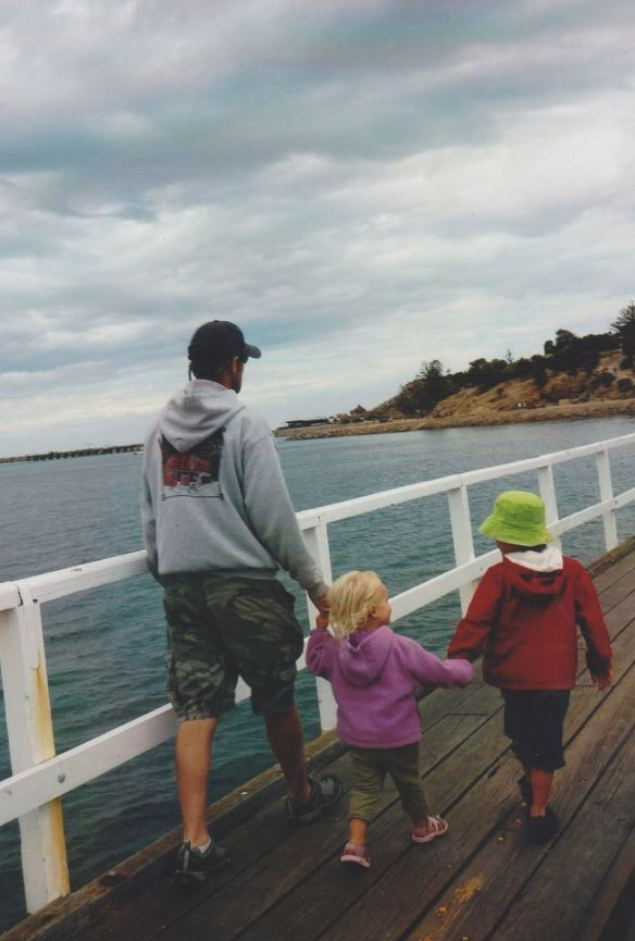 Kurt, Kasey and Eddie walking along a bridge to Granite Island off the coast of Victor Harbour, South Australia.