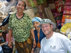 Finding a moment: My husband, Kurt, jokes with a woman and her mother at the handicraft market in Ubud, Bali. Kurt knows how to bargain properly.