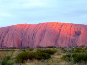 Finding a moment: After a socked in day of clouds, the sun peeks out just in time to do its magic with Uluru. You could sense the Dreamtime at work.