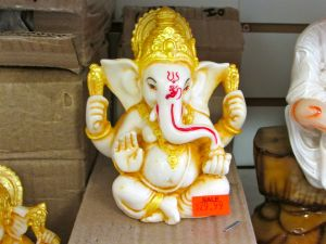 white and gold ganesha