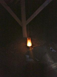Kurt set a lantern on a rock table under the abandoned pergola. Creepy, indeed.