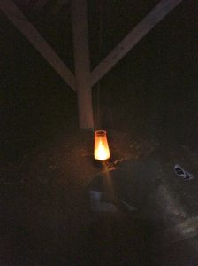 Kurt set a lantern on a rock table under the abandoned pergola. Creepy, indeed.