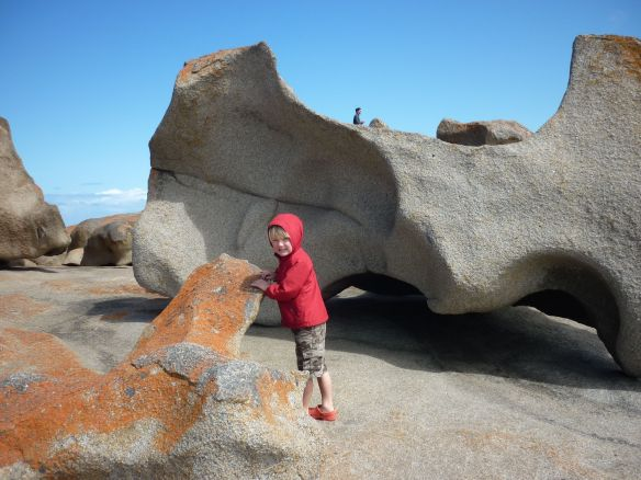 The rock behind Eddie almost looks like a dinosaur bone. At the Remarkable Rocks, Kangaroo Island, SA