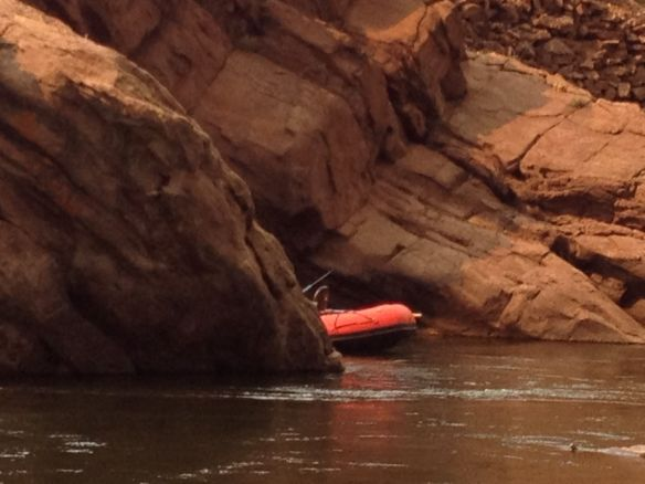 A raft emerges from around the corner of granite rocks along the canyon of Fremont Co., Colorado (2013)