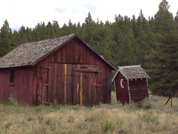 Another building along with an outhouse on the church property.