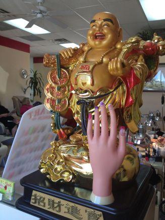 The Buddha and creepy hand at VN nails.