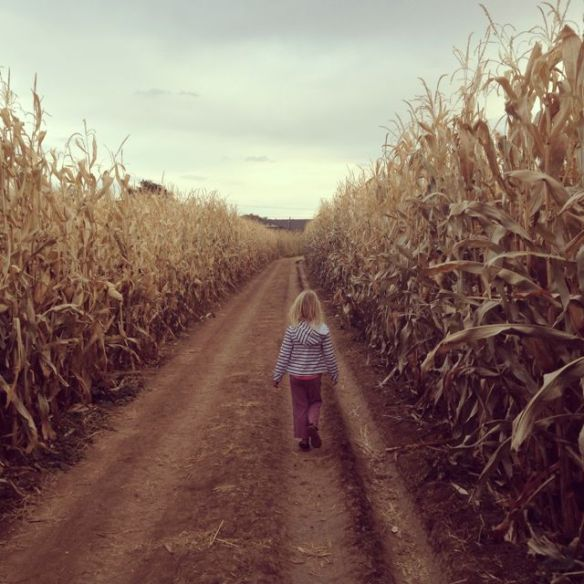 My daughter, Kasey, walking down a dirt road next to the corn maze