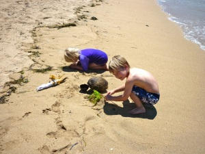 Kasey and Eddie with treasures on the beach in Sanur.