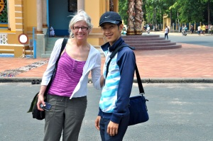 Binh and I stand outside the Cao Dai temple. It was too hot to sing.