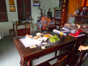 The table by the shrine at Silk's aunt and uncle's house.