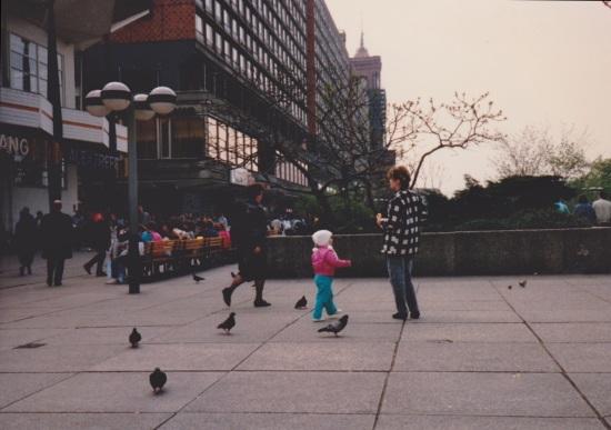 kid chasing pidgeons lightly enhanced