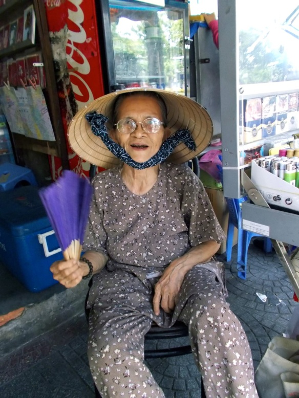 older woman with fan