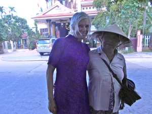 older woman with steph in ao dai