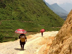 Hmong women with umbrellas