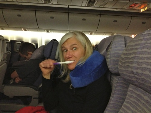Steph brushing teeth on China Airlines flight 2