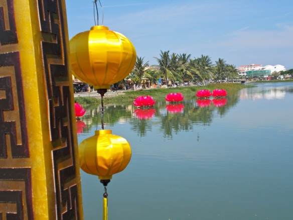 Yellow lanterns match the mustard colored architecture in Hoi An.