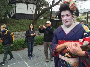 People getting photos of the gringo geishas.