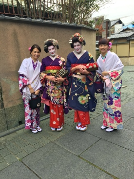 With our new friends. Suz and I are trying hard to bring dignity to the geisha image.