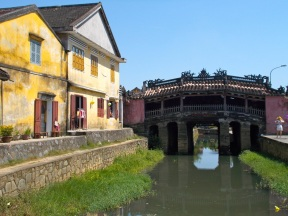 japanese bridge next to colonial building