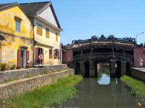 japanese bridge next to colonial building