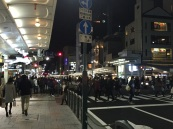 people streaming out on the Kyoto streets nigh